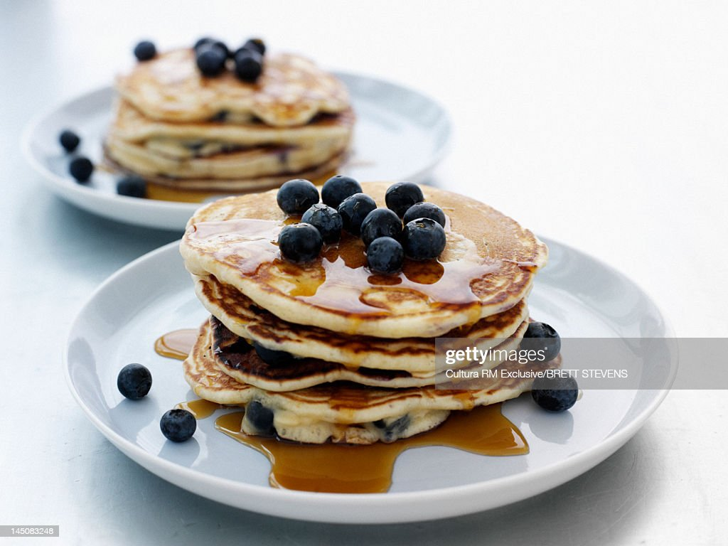 Pancakes with blueberries and syrup : Stock Photo
