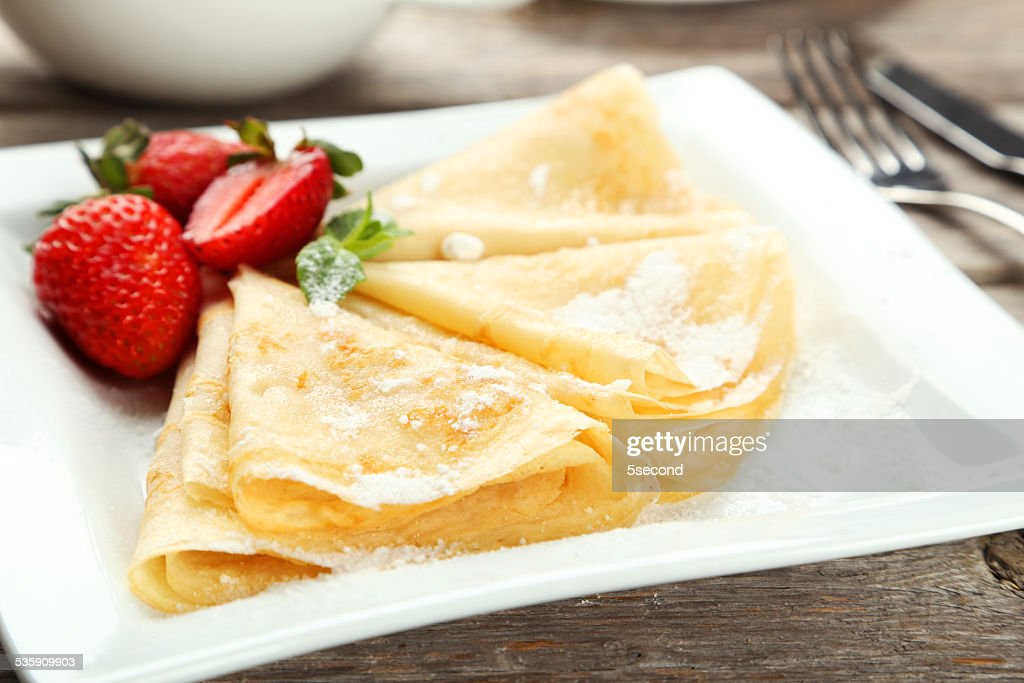 Pancakes with strawberry on plate on grey wooden backgound : Stock Photo