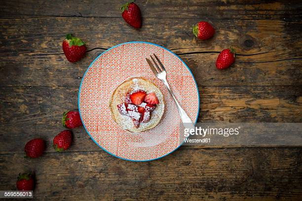 Pancakes with strawberry sauce and strawberries