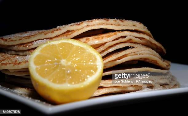 Pancakes with sugar and lemon which are traditionally made on Shrove Tuesday to use up any remaining milk eggs and butter before Lent begins tomorrow