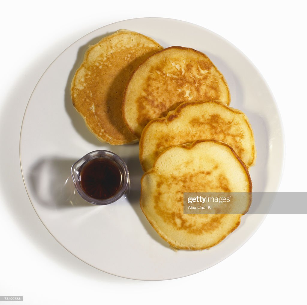 Pancakes with syrup on plate : Stock Photo