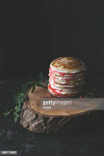 Pancakes with yogurt and sweet strawberry syrup