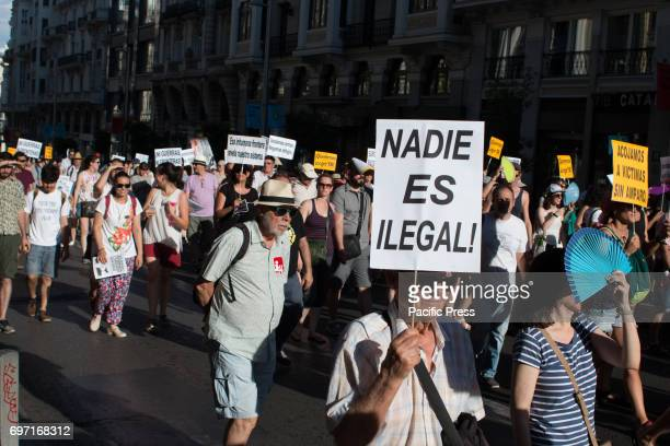 A pancart which says 'Nobody is illegal' Thousands of people march for the reception of the refugees that Spain must accept