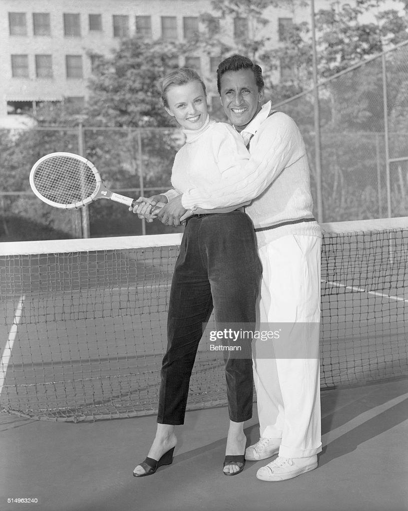 Pancho Segura Giving Tennis Lessons to Ann Baker