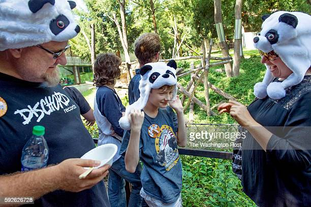 Panda enthusiats Angela Ramsey husband Heiko and 10yrold son Liam wear panda garb as the Zoo celebrates the first birthday of Bei Bei at the...