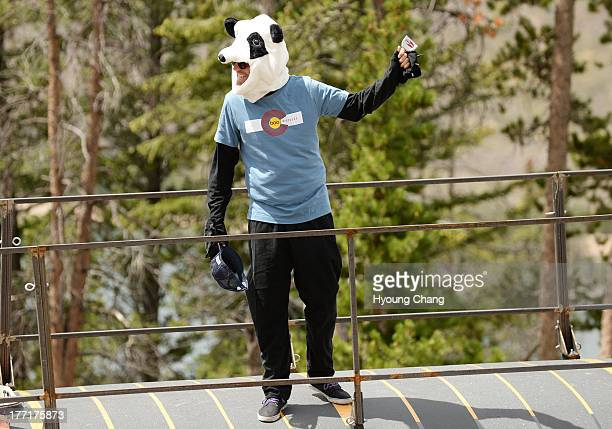 Panda mascot of Boo Bicycles cheer the cyclists during 1069 mi third stage of 2013 USA Pro Challenge race from Breckenridge to Steamboat Springs...