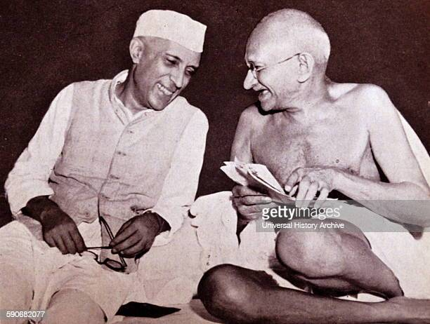 Pandit Jawaharlal Nehru later Prime Minister of India with Mohandas Karamchand Gandhi the preeminent leader of the Indian independence movement in...