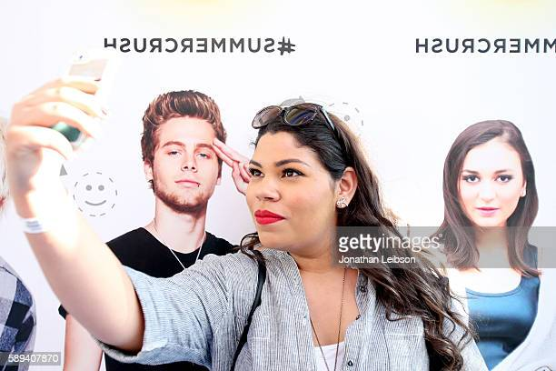 Pandora listener takes a selfie on the 'Face Swap' wall during Pandora Summer Crush at LA Live on August 13 2016 in Los Angeles California