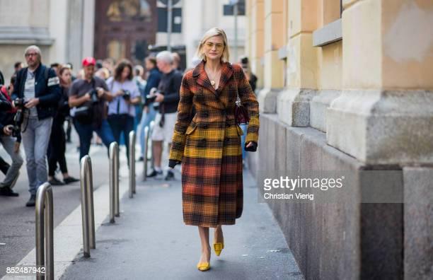 Pandora Skies wearing checked coat is seen outside Bottega Veneta during Milan Fashion Week Spring/Summer 2018 on September 23 2017 in Milan Italy