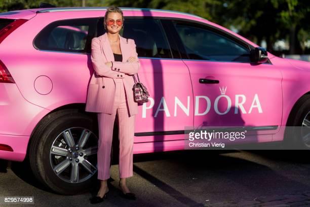 Pandora Sykes wearing a pink suit Chanel bag outside Saks Potts on August 10 2017 in Copenhagen Denmark