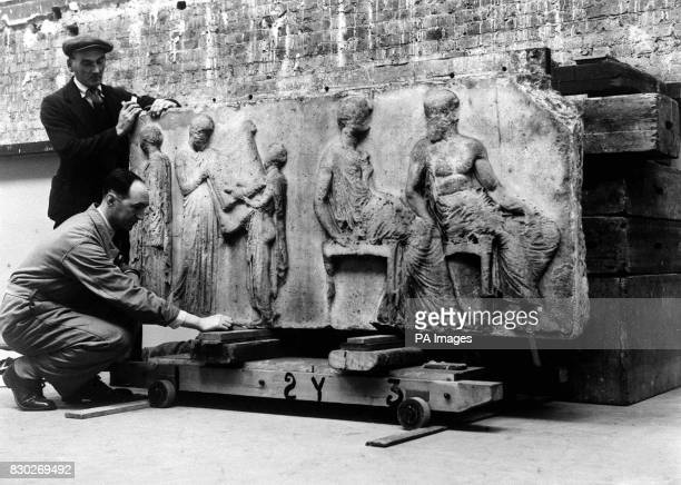 A panel from the Elgin Marbles being handled by porters after being stored in an underground tunnel for safety during the Second World War The...