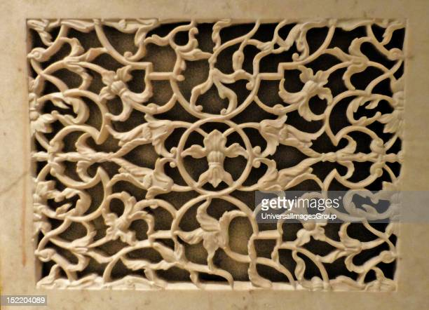 Panel Marble inlaid with yellow and black marble and cornelian c1880 after a Mughal original of 1628 The decoration on this panel was probably copies...