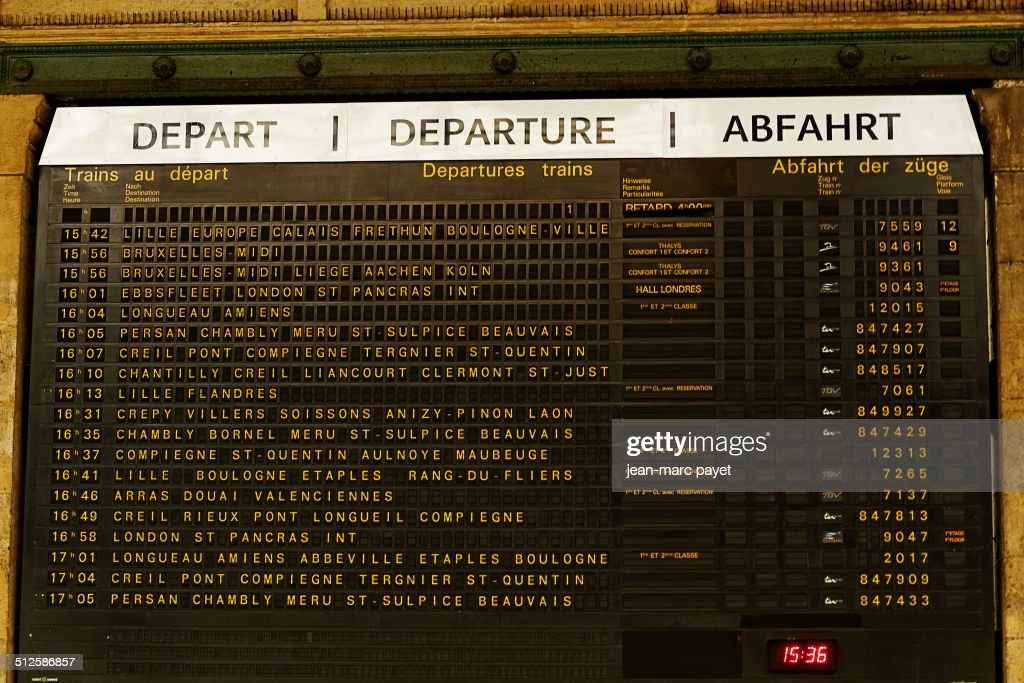 Panel of arrivals and departures of trains from Gare du Nord in Paris in France