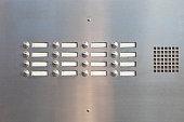 A panel of doorbells