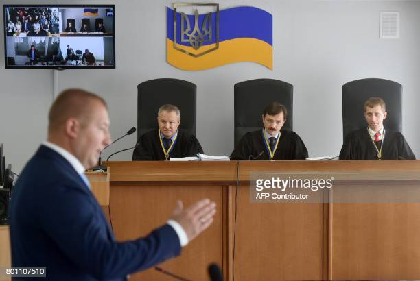A panel of three judges listen to Yanukovychs lawers on June 26 2017 in Kiev on the first day of hearing the merits of the case of deposed...