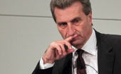 Panel participants European Union Energy Commissioner Guenther Oettinger reacts during a discussion during day 1of the 48th Munich Security...