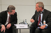 Panel participants European Union Energy Commissioner Guenther Oettinger and Michael Diekmann of Allianz SE chat together during day 1of the 48th...