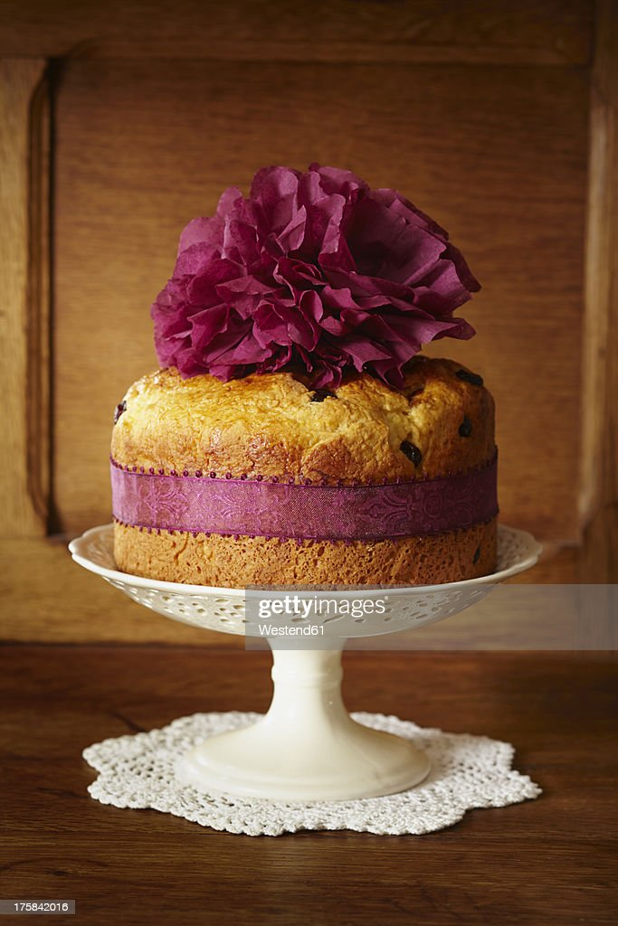 Panettone cake with cranberries on cake stand