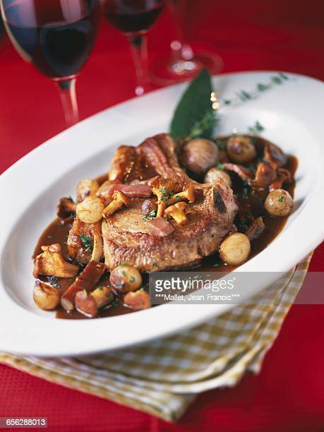 Pan-fried veal chop with chanterelles,small onions and diced bacon