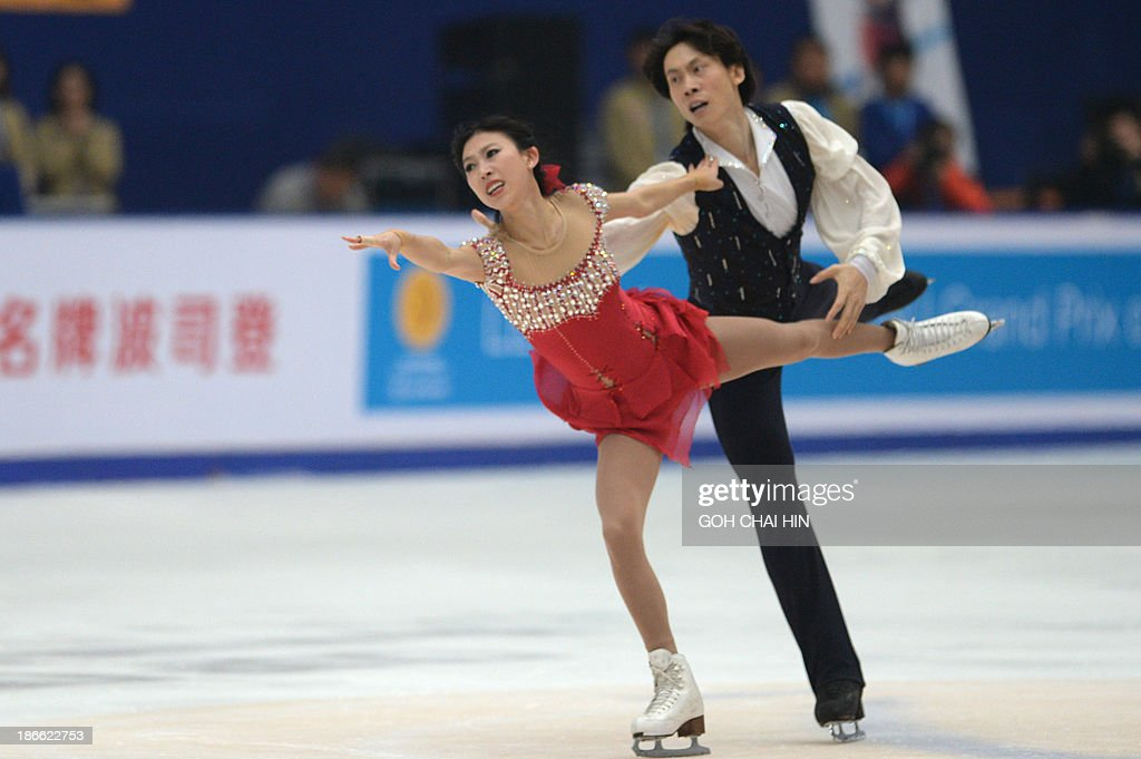 Pang Qing (L) and Tong Jian of China perform during their pairs free skating event of the Cup of China ISU Grand Prix of Figure Skating in Beijing on November 2, 2013. Pang and Tong won second place with a score of 194.38.
