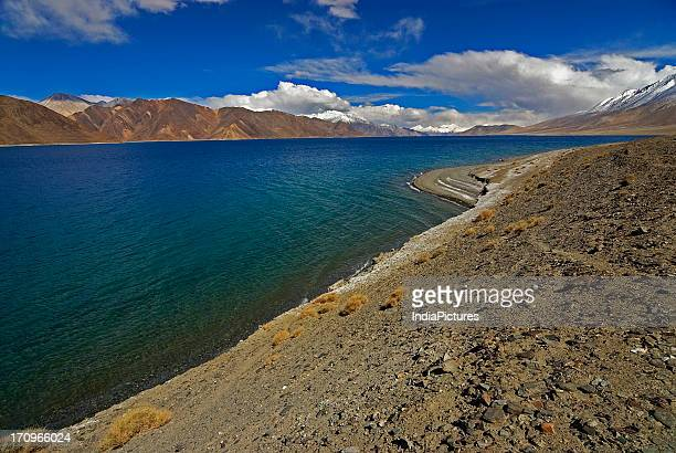 Pangong Lake is a salt lake in Leh and is 150 Kms long About 50 kms is in India and the rest is in the territory of China It is about 160 kms away...