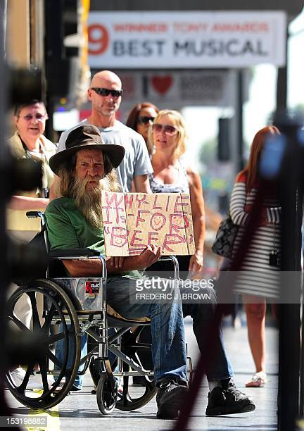 A panhandler on his wheelchair offers an honest assesment on why he chooses to ask for money from people passing on Hollywood Boulevard in Hollywood...