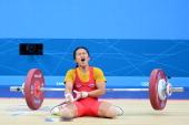 Panida Khamsri of Thailand reacts in the Women's 48kg Group A weightlifting on Day 1 of the London 2012 Olympic Games at ExCeL on July 28 2012 in...