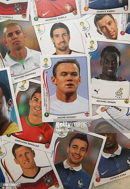 Panini World Cup stickers are displayed including one of England star Wayne Rooney on May 28 2014 in Rio de Janeiro Brazil Fans of World Cup Soccer...