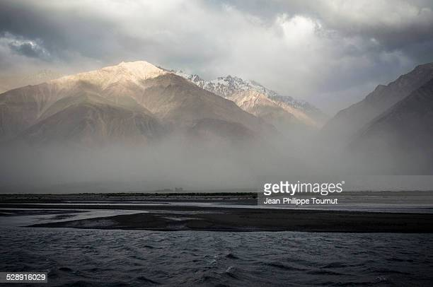 Panj river and the Hindu Kush during a sandstorm