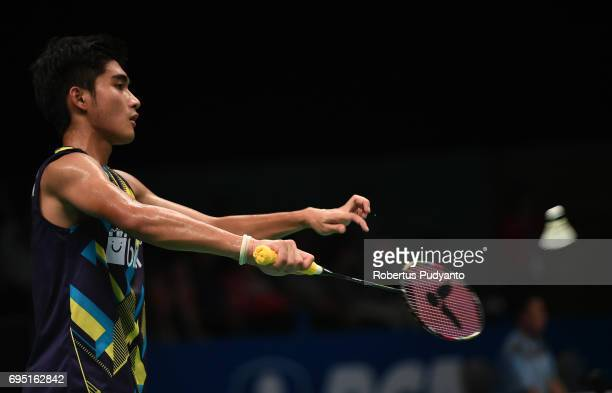 Panji Ahmad Maulana of Indonesia competes against Suppanyu Avihingsanon of Thailand during Mens single qualification round match of the BCA Indonesia...