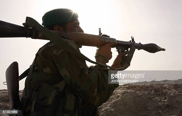 A soldier from the Afghan National Army aims a Rocket Propelled Grenade during an Afghanled operation to arrest suspected Talibans operating in the...