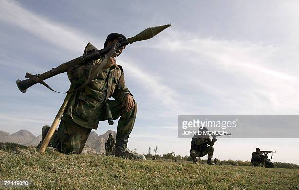 A soldier from the Afghan National Army carries his Rocket Propelled Grenade launcher during a foot patrol in a volatile area in Panjwayi district...
