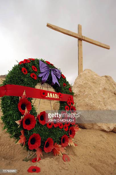 A wreath stands beside a makeshift memorial during a Remembrance Day ceremony attended by Canadian soldiers and personnel from British US and Afghan...