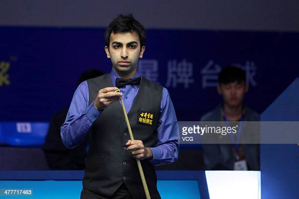 Pankaj Advani of India chalks his cue against Xiao Guodong of China on Day one of the 2014 Snooker Haikou World Open on March 10 in Haikou Hainan...