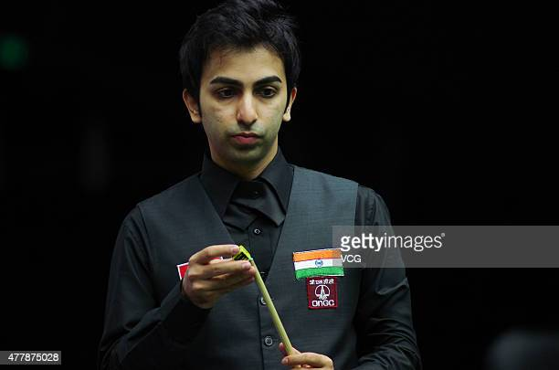 Pankaj Advani of India chalks his cue in quarterfinals match against Luca Brecel of Belgium on day six of Snooker World Cup 2015 at Wuxi Stadium on...