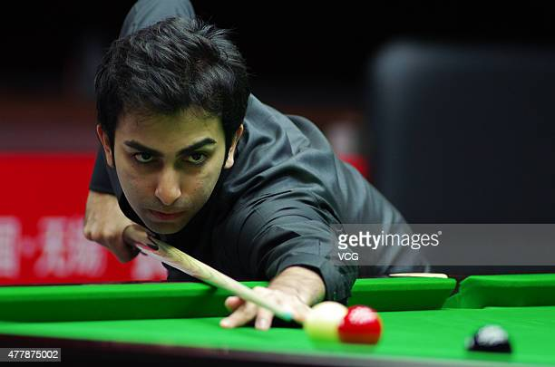 Pankaj Advani of India plays a shot in quarterfinals match against Luca Brecel of Belgium on day six of Snooker World Cup 2015 at Wuxi Stadium on...