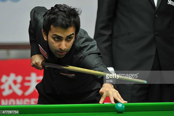 Pankaj Advani of India plays a shot in the match against China A on day one of Snooker World Cup 2015 at Wuxi Stadium on June 15 2015 in Wuxi China