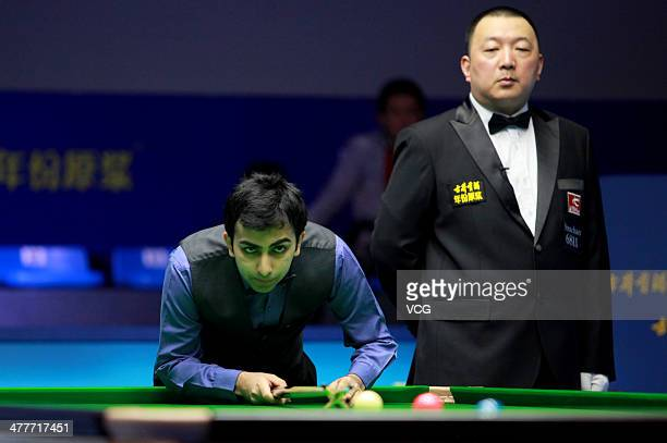 Pankaj Advani of India reacts against Xiao Guodong of China on Day one of the 2014 Snooker Haikou World Open on March 10 in Haikou Hainan China