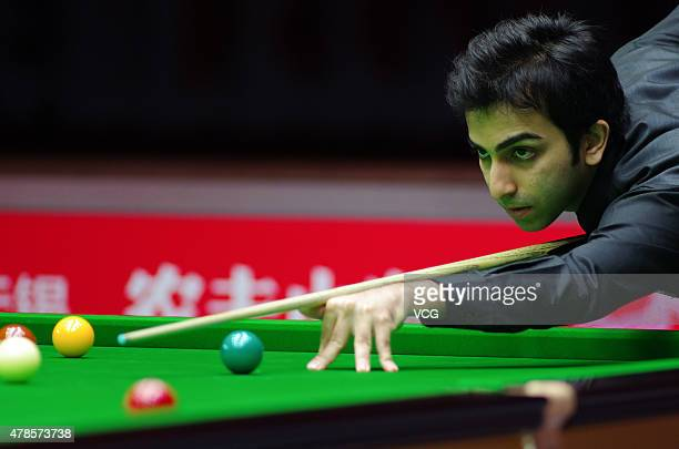 Pankaj Advani of Indian plays a shot in quarterfinals match against Luca Brecel of Belgium on day six of Snooker World Cup 2015 at Wuxi Stadium on...