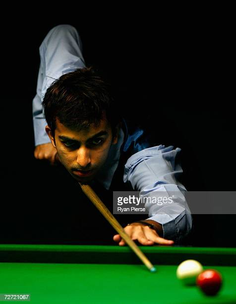 Pankaj Arjan Advani of India plays a shot during the Men's English Billiards Singles semifinal match against Aung San Oo of Malaysia during day five...