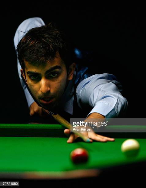 Pankaj Arjan Advani of India plays a shot during the Men's English Billiards Singles semi final match against Aung San Oo of Malaysia during day five...