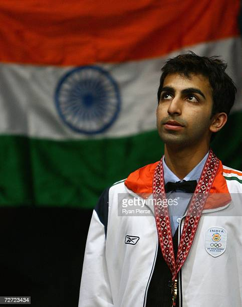 Pankaj Arjan Advani of India sings the national anthem after claiming the Gold Medal in the Men's English Billiards Singles Final match against Ashok...