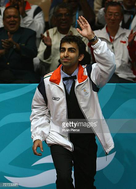 Pankaj Arjan Advani of India steps up to the podium after claiming the Gold Medal in the Men's English Billiards Singles Final match against Ashok...