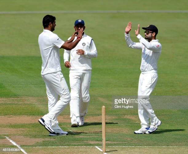 Pankaj Singh of India celebrates after he takes the wicket of Derbyshire's Paul Borrington during day one of the tour match between Derbyshire and...