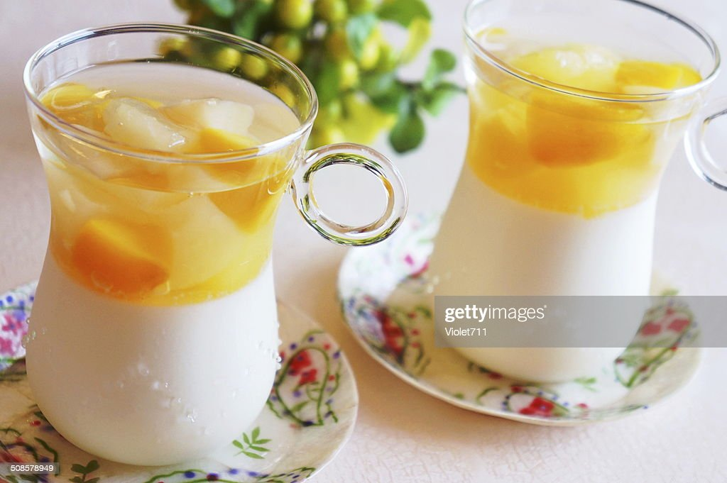 Panna Cotta with fruit jelly. : Stockfoto