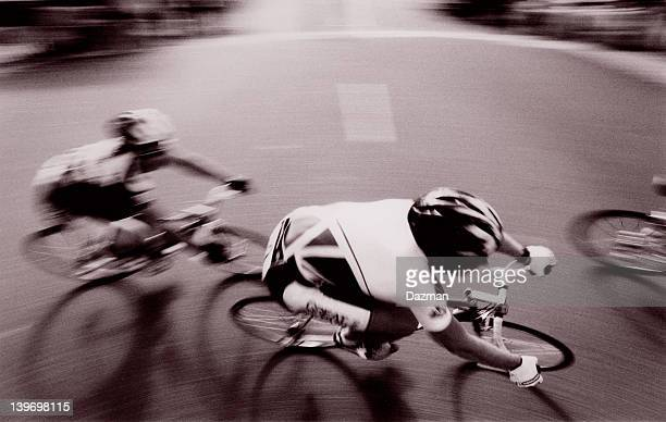 Panned action photo of cyclists competing in a bicycle race.