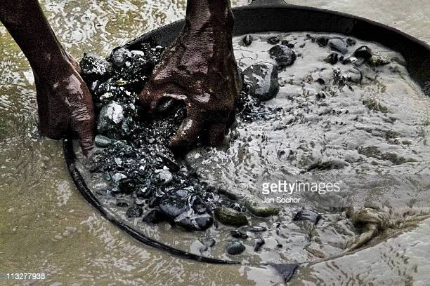 Panning is the prevailing technique of extracting gold in Agua Clara gold mine near Tadó city on May 26 2004 in Chocó Colombia This place where...
