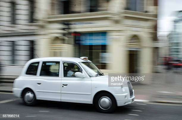 Panning of white taxi cab