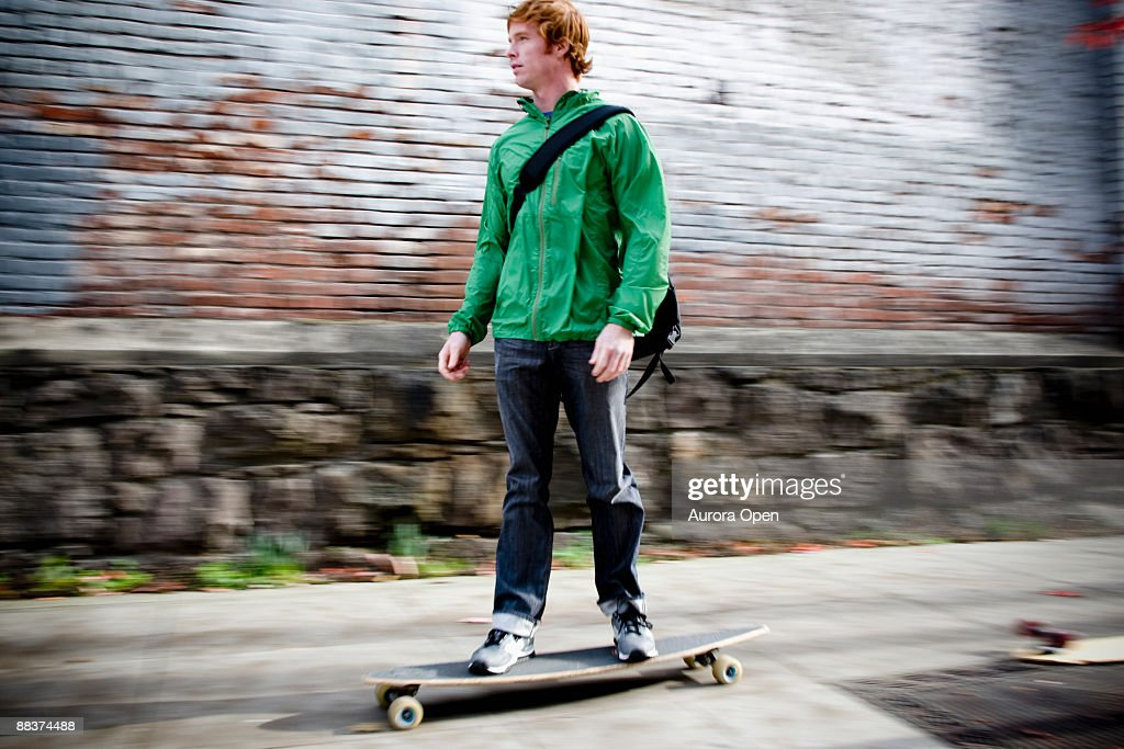 A panning shot of a skateboarder. : Stock Photo