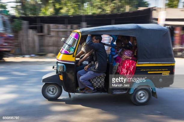 Panning shot of Autorickshaw / three-wheeler
